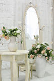 Beautiful classical room with vintage table, vase and flowers, heart decorations and pictures. Classical room with vintage table, vase and flowers, heart Royalty Free Stock Photography