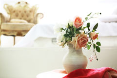 Beautiful classical room with vintage table, vase and flowers, heart decorations and pictures Stock Image