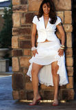 Beautiful Classy Latin Woman. Latin woman in white dress showing off her legs royalty free stock images
