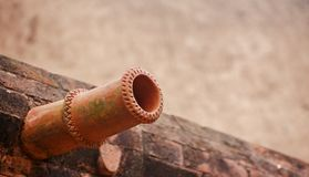 Red pipe shape object unique photo. Beautiful clay made pipe unique royalty free image stock images