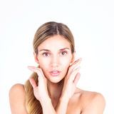 Beautiful and clean face of woman. Beautiful woman touching her face with both hands Royalty Free Stock Photo