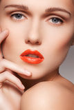 Beautiful clean model face with bright red lips make-up Royalty Free Stock Photography
