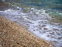 Sea and small stones beach stock photography