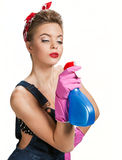 Beautiful cleaning girl wearing pink rubber protective gloves holding spray Royalty Free Stock Images