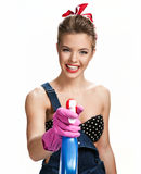 Beautiful cleaning girl wearing pink rubber protective gloves holding spray Royalty Free Stock Photo