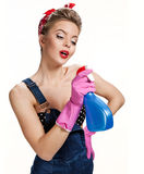 Beautiful cleaning girl wearing pink rubber protective gloves holding spray Royalty Free Stock Image