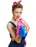 Beautiful cleaning girl wearing pink rubber protective gloves holding spray Stock Image