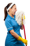 Beautiful cleaning lady pretending to be a singer Stock Photo
