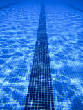 Beautiful clear pool water lit by the sun Royalty Free Stock Image