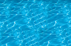 Beautiful clear pool water reflecting in the sun Royalty Free Stock Photography