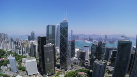 Beautiful Clear Sky Hong Kong City Aerial. 4K Aerial view of Central of Hong Kong. Tight aerial backward shot flying over office buildings and skyscrapers stock video