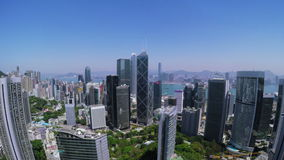 Beautiful Clear Sky Hong Kong City Aerial. 4K Aerial view of Central of Hong Kong. Tight aerial forward shot flying over office buildings and skyscrapers stock footage