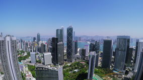 Beautiful Clear Sky Hong Kong City Aerial. 4K Aerial view of Central of Hong Kong. Wide aerial backward shot flying over office buildings and skyscrapers stock video
