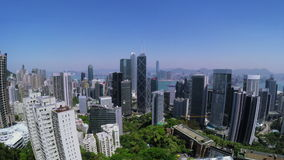 Beautiful Clear Sky Hong Kong City Aerial. 4K Aerial view of Central of Hong Kong. Wide aerial forward shot flying over office buildings and skyscrapers stock video
