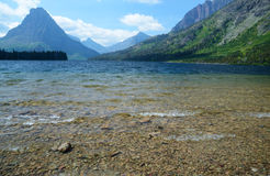 Beautiful clear waters of lake in Glacier National Park. Stock Images
