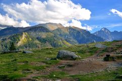 Beautiful clearing in mountains. Rusinowa Glade is one of the beautiful place in Polish Tatra Mountains. View over high summits royalty free stock photo