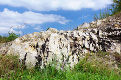 Beautiful cliff with blue sky. And grass at Rayong beach stock photo