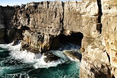 Cliff formation in Cascais called The Boca do Inferno. Beautiful cliff formation close to Cascais called The Boca do Inferno beach coast rocky foam erosion stock image
