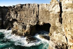 Cliff formation in Cascais called The Boca do Inferno. Beautiful cliff formation close to Cascais called The Boca do Inferno beach coast rocky foam erosion stock photos
