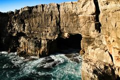 Cliff formation in Cascais called The Boca do Inferno. Beautiful cliff formation close to Cascais called The Boca do Inferno beach coast rocky foam erosion royalty free stock images