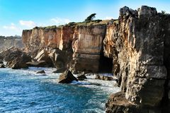 Cliff formation in Cascais called The Boca do Inferno. Beautiful cliff formation close to Cascais called The Boca do Inferno beach coast rocky foam erosion royalty free stock photo