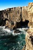 Cliff formation in Cascais called The Boca do Inferno. Beautiful cliff formation close to Cascais called The Boca do Inferno beach coast rocky foam erosion stock photo