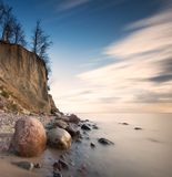 Beautiful cliff on sea shore. Long exposure photo Royalty Free Stock Images