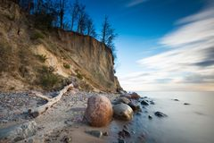 Beautiful cliff on sea shore. Long exposure photo Stock Photos