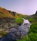 Beautiful cliffs and stream at sunset Royalty Free Stock Images