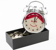 Beautiful clock staying on Baht coins with box. Stock Image