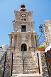 Beautiful Clock Tower in medieval Old Town of Rhodes stock images