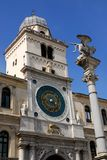 Beautiful clock tower in Padua in the Veneto (Italy). Photo taken in Piazza dei Signori in Padova in Veneto (Italy). In the picture you see, illuminated by the stock image