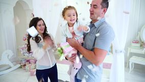 Friendly Family Happily Spending Time Together and Having Fun Meet New Year Beside Bed in Bright Room on Background of. Beautiful and Close-Knit Family of Three stock video