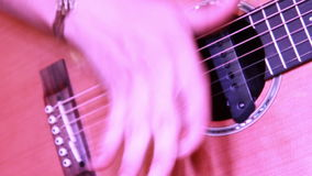 Beautiful close up of the acoustic guitar while playing stock footage