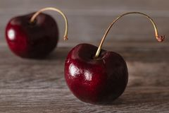 Cherries on a wooden background royalty free stock image