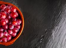 Beautiful close-up of cluster of red grapes inks on table. royalty free stock photo