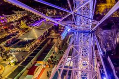 Beautiful close up of the metal structure of the wheel of fortune. With a combination of purple blue lights, a christmas fair in Maastricht, Limburg the royalty free stock image