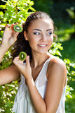 Beautiful close-up portrait of young woman with kiwi Stock Photography