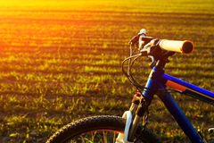 Beautiful close up scene of bicycle at sunset, Stock Image