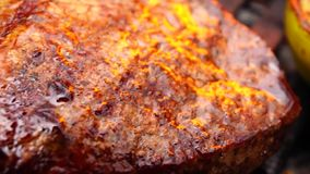 Beautiful close up view on big fresh fat piece of delicious beef steak pink juicy meat cooked fried grilled on grill pan stock video footage