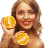 Beautiful close-up young woman with oranges Royalty Free Stock Photography