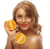 Beautiful close-up young woman with oranges Stock Photography