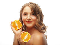 Beautiful close-up young woman with oranges Stock Image