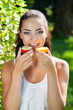 Beautiful close-up young woman with red apple Stock Photography