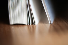 A beautiful closeup of a book in dark red cover and with red bookmark. Stock Images