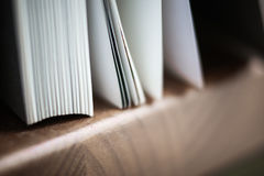A beautiful closeup of a book in dark red cover and with red bookmark. Stock Photos