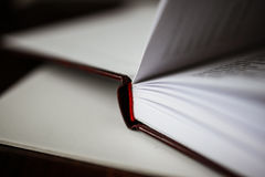 A beautiful closeup of a book in dark red cover and with red bookmark. Royalty Free Stock Photo
