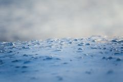 A beautiful closeup of a frozen sea water on the coast of Baltic sea. Frozen salt water vawes on a beach. Abstract closup of ice Stock Photos