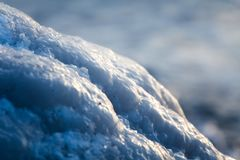 A beautiful closeup of a frozen sea water on the coast of Baltic sea. Frozen salt water vawes on a beach. Abstract closup of ice Royalty Free Stock Image