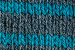 A beautiful closeup of a hand knitted warm and soft wool pattern. Soft socks or scarf of natural wool. Royalty Free Stock Photography